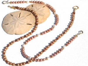 Copper and white cultured pearls